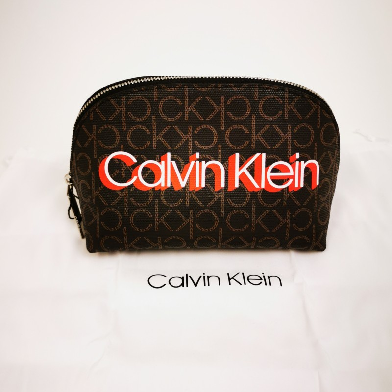 CALVIN KLAIN -  Beauty-case Monogram in leather - Brown