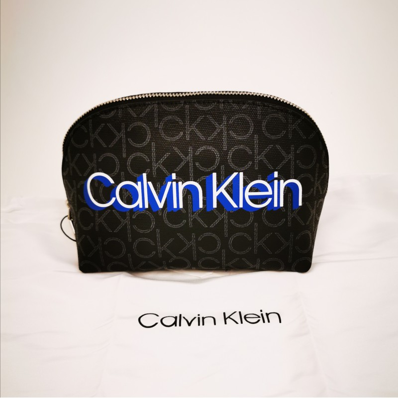 CALVIN KLAIN -  Beauty-case Monogram in leather - Black